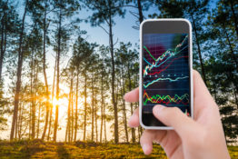 Traveller using smart phone analysis stock market