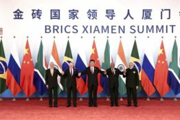In this photo released by Xinhua News Agency, BRICS leaders from left, Brazilian President Michel Temer, Russian President Vladimir Putin, Chinese President Xi Jinping, South African President Jacob Zuma, and Indian Prime Minister Narendra Modi hold each other hands as they pose for a group photo at the BRICS Summit in Xiamen in southeastern China's Fujian Province, Monday, Sept. 4, 2017. (Pang Xinglei/Xinhua via AP)