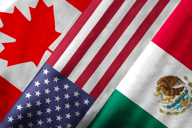 Closeup of the flags of the North American Free Trade Agreement NAFTA members on textile texture. NAFTA is the world's largest trade bloc and the member countries are Canada, United States and Mexico. 3D rendering with detailed textured grunge effect on closeup.